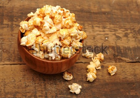 popcorn in wooden bowl on wooden table  Stock photo © inxti