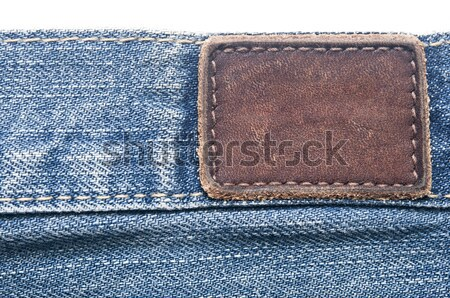 Leather jeans label sewed on jeans.  Stock photo © inxti