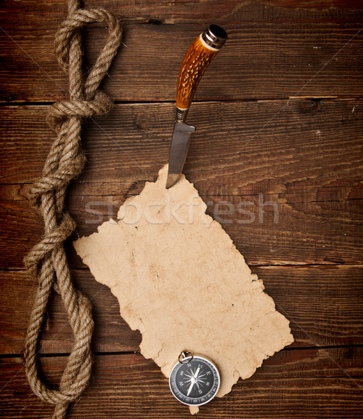 Old paper pinned to a wooden wall with a knife Stock photo © inxti