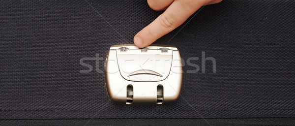 closeup photo of a combination lock on a black suitcase with chi Stock photo © inxti