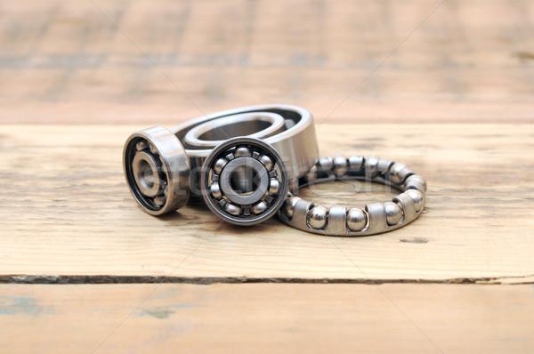 steel ball bearings on wooden table Stock photo © inxti