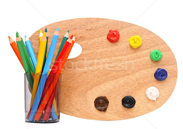 wooden artists palette loaded with various colour paints and col Stock photo © inxti