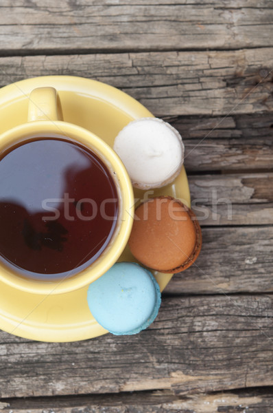 colorful macaroon with a cup of coffee on old wooden background  Stock photo © inxti