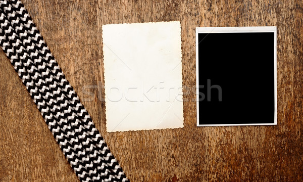 Old photo frames on vintage wood background with rope  Stock photo © inxti