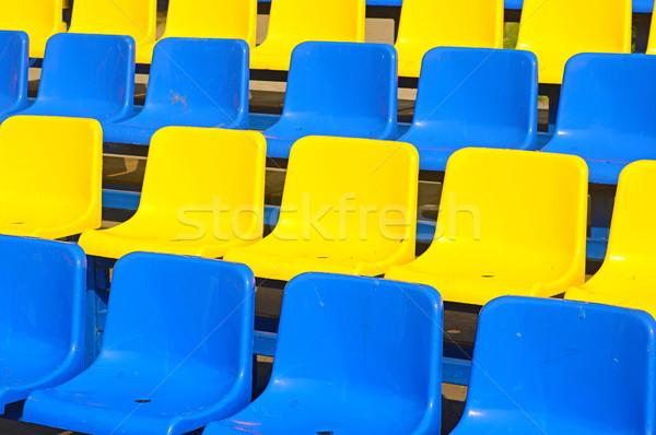 Empty plastic seats in a stadium  Stock photo © inxti