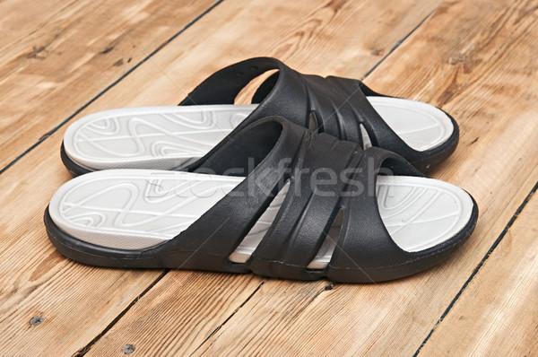 black flip flops on wooden deck. summer background Stock photo © inxti