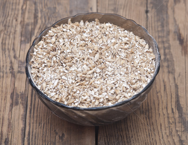 Pale malt barley in a glass bowl, an ingredient for beer.  Stock photo © inxti