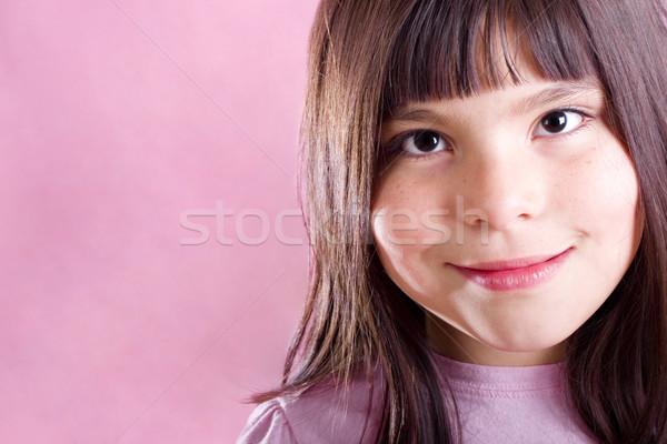 Cute ragazza sorridere rosa copia spazio sfondo Foto d'archivio © iodrakon