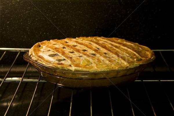 Pie in Oven Stock photo © iodrakon