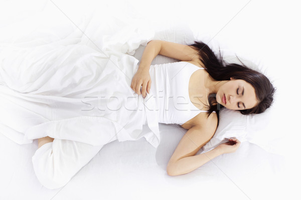 Young woman sleeping on white bed Stock photo © iodrakon