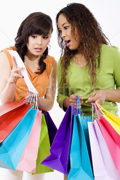 Winkelen voorraad afbeelding twee verwonderd jonge vrouwen Stockfoto © iodrakon