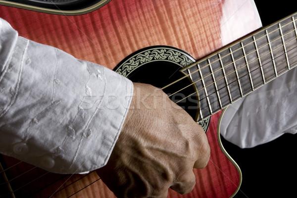 Gitarist adam oynama klasik gitar Stok fotoğraf © iodrakon