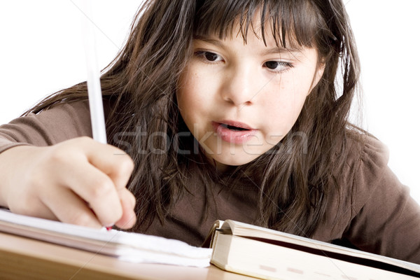 Cute girl doing homework Stock photo © iodrakon