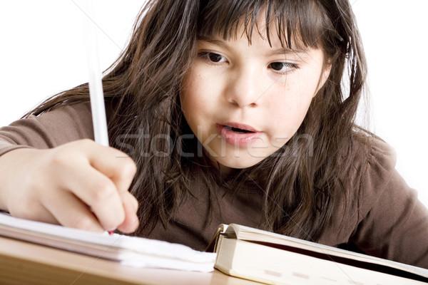 Cute Mädchen Hausaufgaben weiß Buch Stock foto © iodrakon