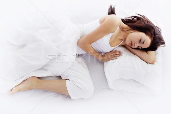 Young woman sleeping on white bed  Stock photo © iodrakon