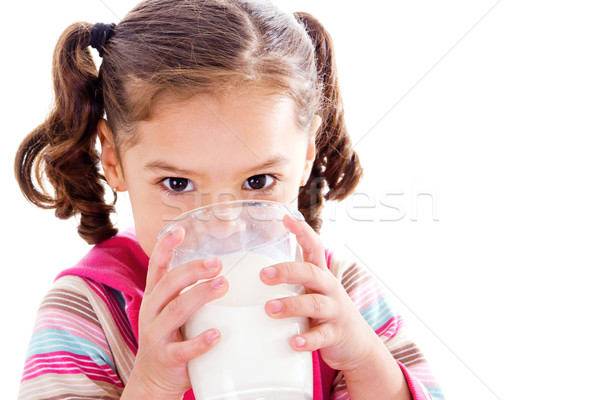 Enfant potable lait stock image Homme Photo stock © iodrakon