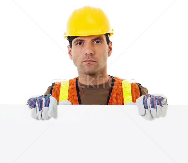 Construction worker holding blank sign Stock photo © iodrakon