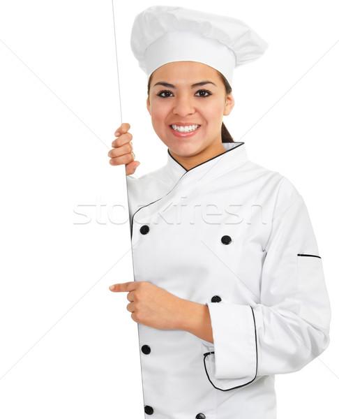 Női szakács stock kép tart üres tábla Stock fotó © iodrakon