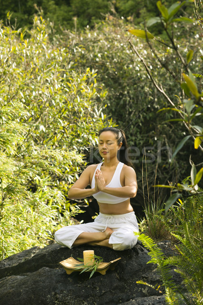 Asian woman meditating. Stock photo © iofoto