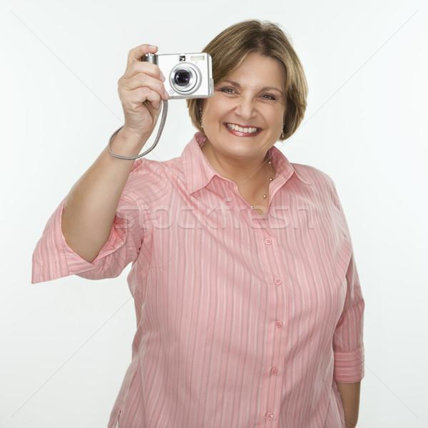 Woman taking photograph. Stock photo © iofoto