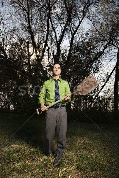 Young Businessman Holding Shovel Stock photo © iofoto