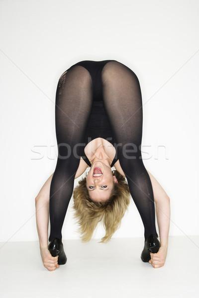 Woman looking through legs. Stock photo © iofoto