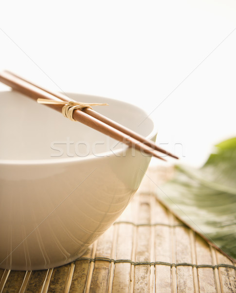 Chopsticks on an Empty Bowl. Isolated Stock photo © iofoto