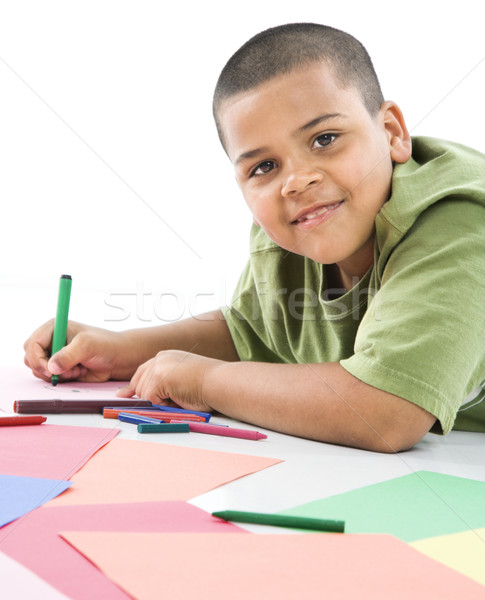 Hispanic boy coloring. Stock photo © iofoto