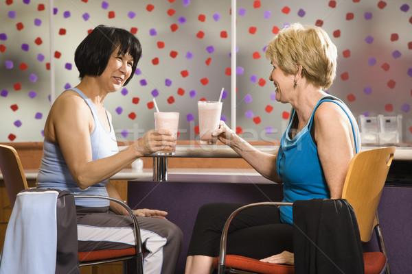 Nők egészség italok érett ázsiai kaukázusi Stock fotó © iofoto