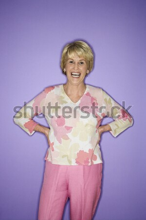 Woman dancing and smiling. Stock photo © iofoto