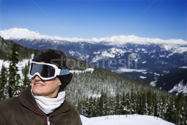 Stock photo: Woman skier in mountains.
