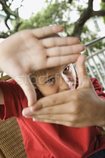 Boy Looking Through Hands Stock photo © iofoto