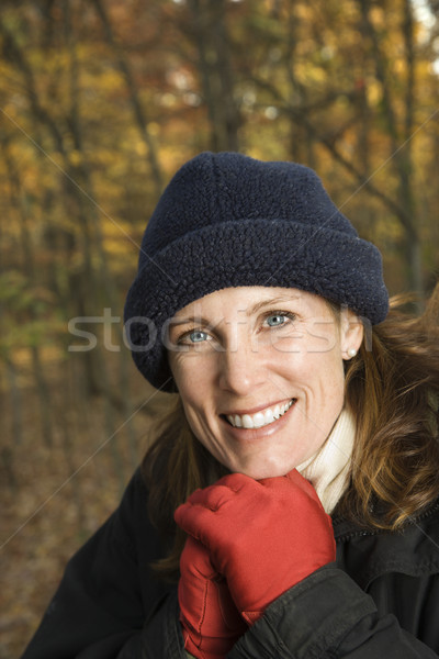 Smiling woman in forest. Stock photo © iofoto