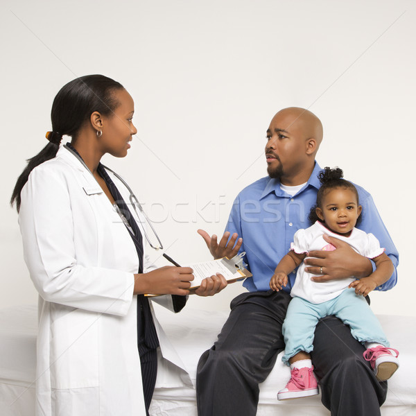 Father, child and doctor. Stock photo © iofoto