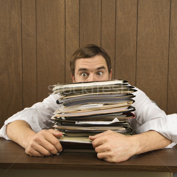 Man with heavy workload. Stock photo © iofoto
