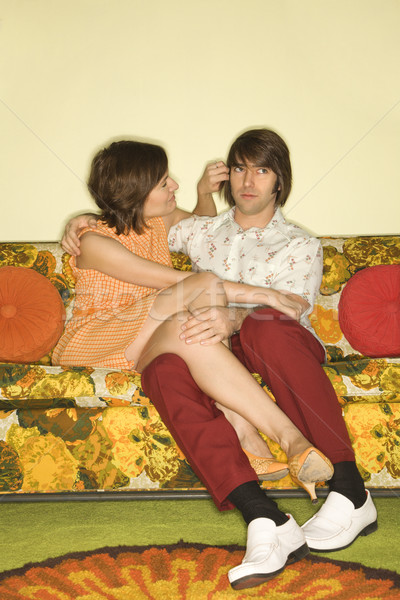 Couple on sofa. Stock photo © iofoto
