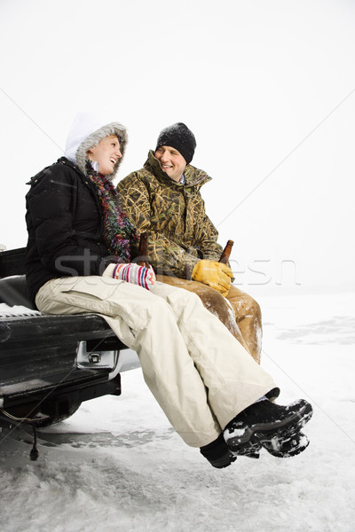 Young Couple Sitting on Truck Tailgate Stock photo © iofoto