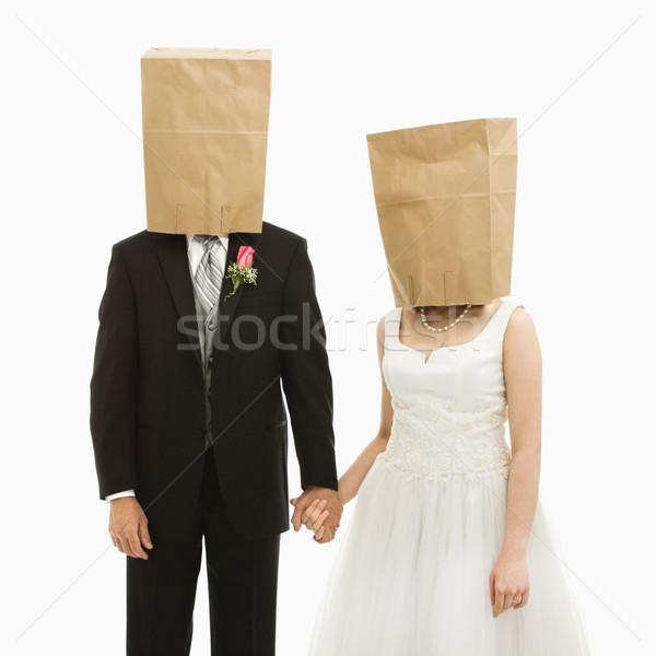 Wedding couple with bags over heads. Stock photo © iofoto