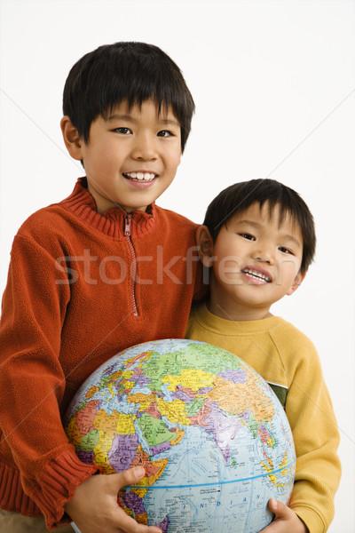 Fiúk tart földgömb kettő ázsiai világ Stock fotó © iofoto