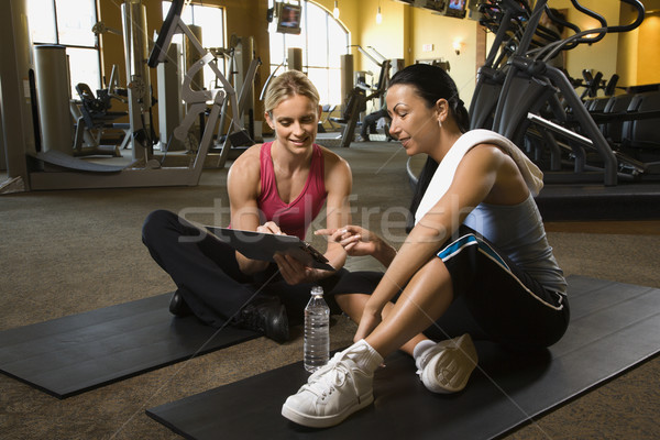 Woman with trainer at gym. Stock photo © iofoto
