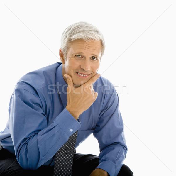 W średnim wieku człowiek uśmiechnięty strony Zdjęcia stock © iofoto