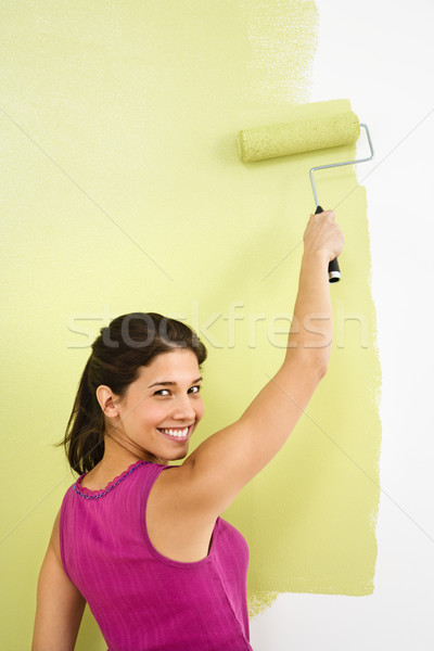 Stock photo: Smiling woman painting.