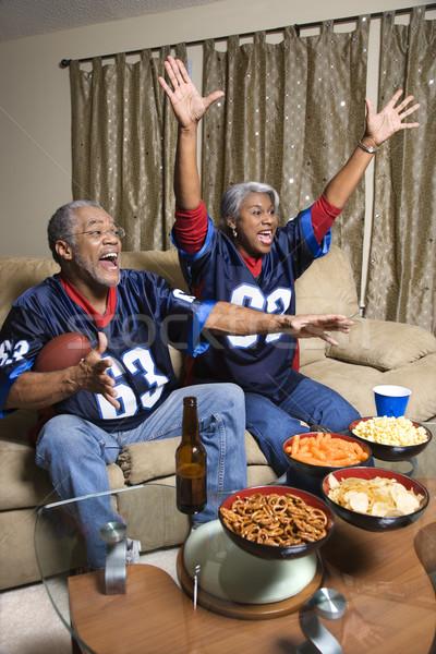 Couple watching sports. Stock photo © iofoto