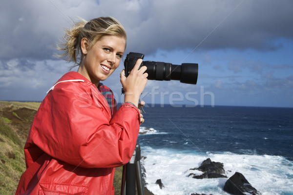 Woman with camera. Stock photo © iofoto