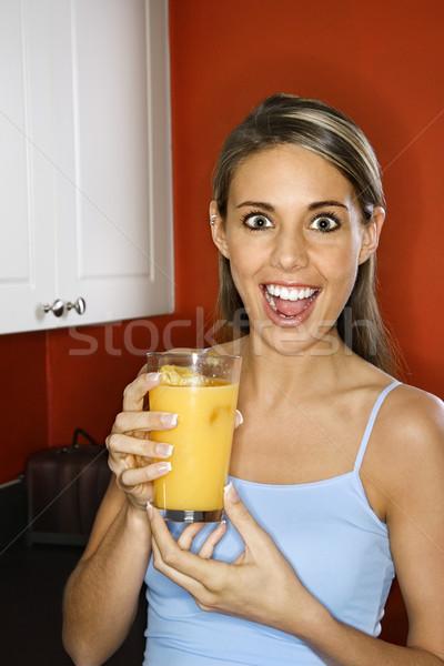 Woman with juice glass. Stock photo © iofoto