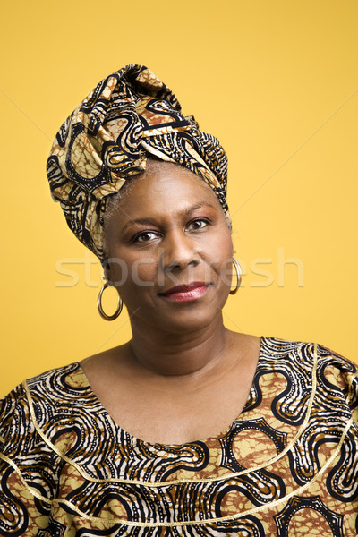 Woman dressed in African costume. Stock photo © iofoto