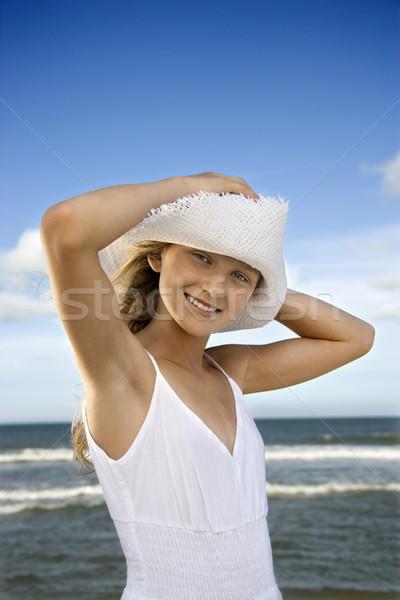 Genç kız plaj şapka aşağı kafa dikey Stok fotoğraf © iofoto