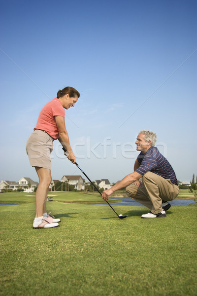 Couple playing golf. Stock photo © iofoto