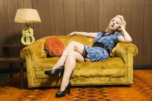 Kobieta retro kanapie atrakcyjny posiedzenia Zdjęcia stock © iofoto