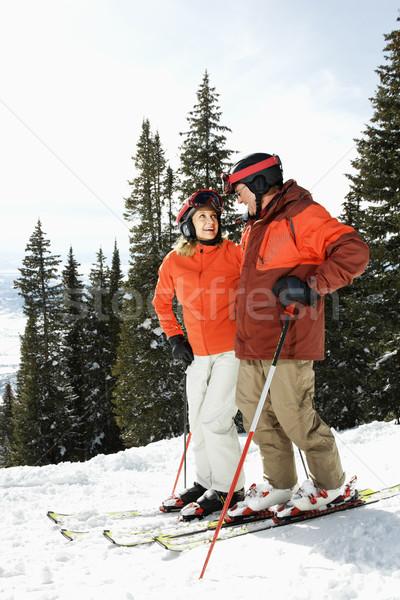 Couple on Skis on Mountain Slope Stock photo © iofoto